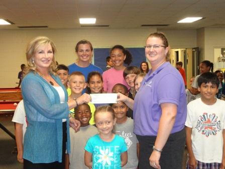 Stefanie Bell given Jessica Bullock a Check for the Wake Forest Boys and Girls Club